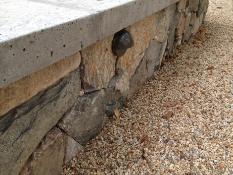 seat wall with colored concrete cap