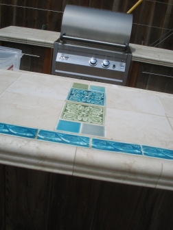 This tilework was done by the homeowner. I selected pottery to coordinate.