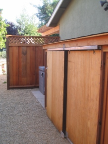 A custom shed designed to reduce noise, helping neighbors compromise on a pool equipment location.