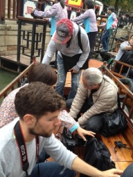 Everybody piles into a traditional canal boat in Tongli.