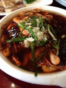 Shrimp in broth with sizzling garlic oil.