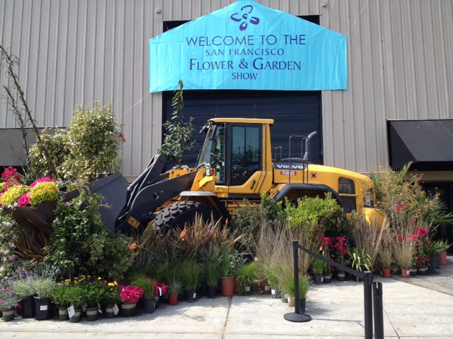 The entry to the San Mateo Event center was dominated by an enormous tractor with a bucket full of plants.