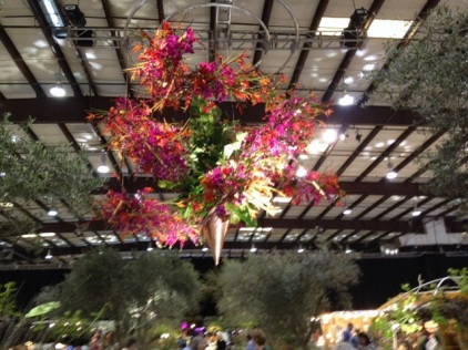 Wow! This amazing floral sculpture was suspended from the ceiling about halfway down the main center aisle of the show. Smashing!